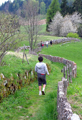 family walking along the mountain path