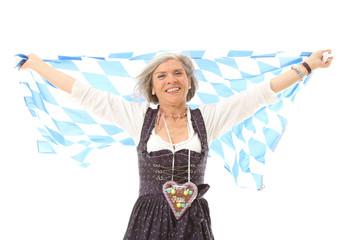 Alte Frau im Dirndl mit  Fahne