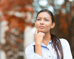Young Businesswoman daydreaming, Thinking, outside background