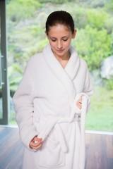 Young woman wearing a bathrobe