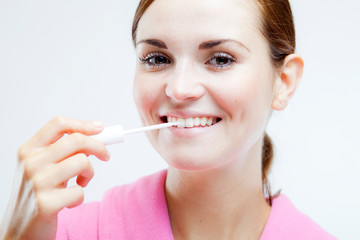 Teeth whitening, woman holding brush