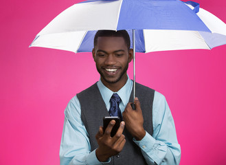 Happy corporate man reading news on phone holding umbrella