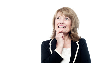 Mature woman thinking isolated on white