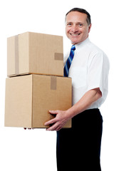 Business executive holding a boxes