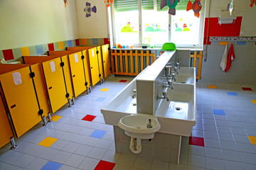 small bathrooms and sinks in a school for young children