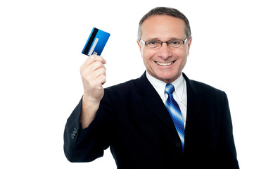 Business executive holding credit card