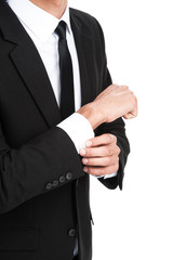 Detail of young businessman adjusting his sleeve.
