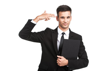 young businessman doing suicide symbol on white.