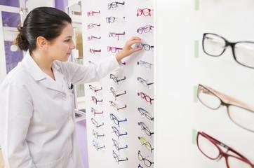 Optometrist woman looking her glasses