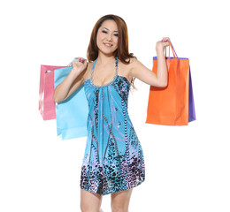 young woman is sexy girl holding shopping colorful bag