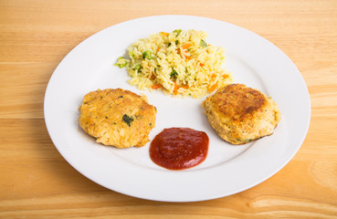 Two Crab Cakes with Cheesy Broccoli Rice