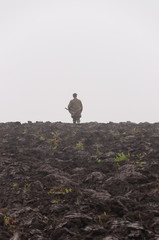 Vertical view of a gamekeeper in autumn fog.