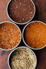 Spice in round bowls: merquen, Za'atar, Ras el hanout,dukkah