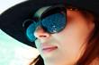 Closeup portrait of a cute woman in sunglasses