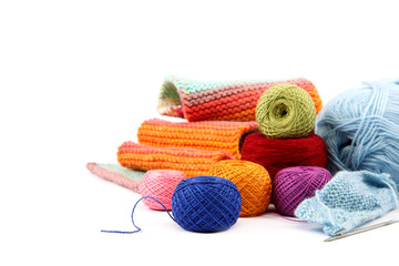 Colored threads and fabric on white background.