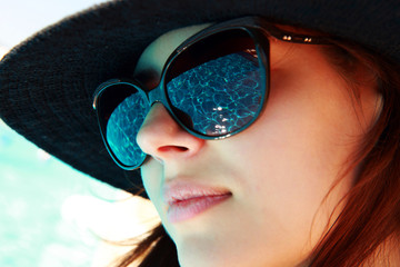 Closeup portrait of a cute woman in sunglasses
