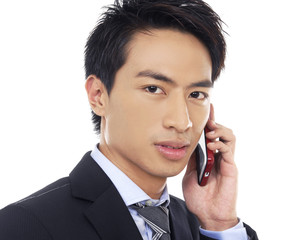 Casual young businessman talking on mobile phone
