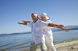 Happy Mature Couple on Ocean Beach