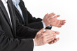 Photo of business people hands applauding at white background.