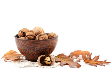Walnuts in wooden bowl. Autumn time.