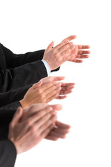 closeup of business people hands applauding at white background.