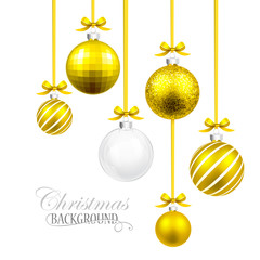 Christmas balls with yellow ribbon and bows