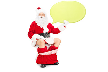 Santa sitting on toilet and holding speech bubble