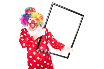 Excited clown holding a big picture frame