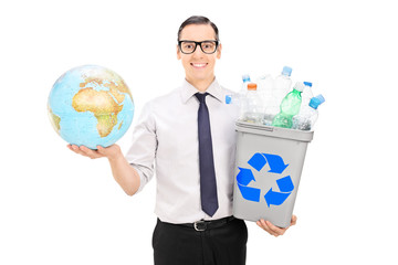 Eco friendly guy holding recycle bin and a globe