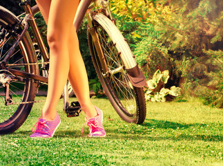 girl standind near bike in the park