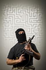 Man with gun and maze.