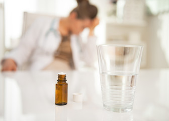 Closeup on antidepressant on table and doctor in background