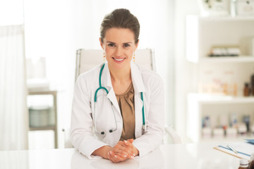 Portrait of smiling doctor woman in office