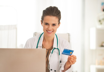 Happy doctor woman making online shopping