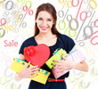 Shopping time.Attractive woman with gift boxes
