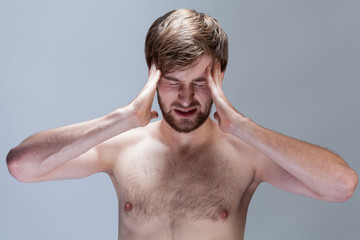 Naked man with strong headache