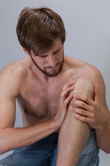 Man with hurting knee
