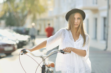 Girl with retro bike