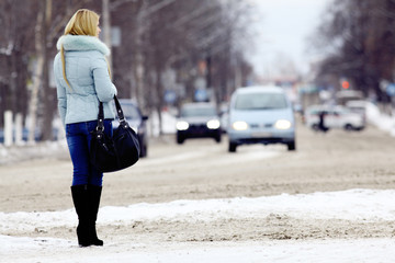 young woman in winter road vehicles pedestrian