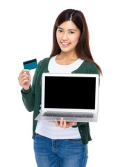 Shopping online concept, Woman hold laptop computer and credit c