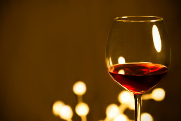 Red wine in glass brown background.autmn fall gift card.