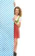 canvas print picture - Junge Frau im dirndl hinter Wand
