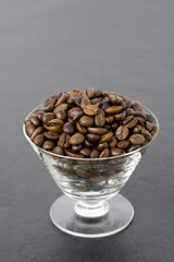 Roasted coffee beans in glass
