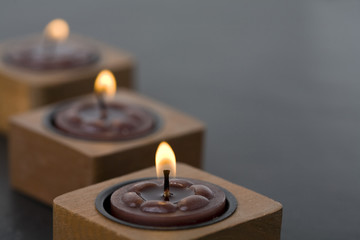 Three small candles in row