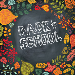 Back to school.Autumn leaves,branches,blackboard