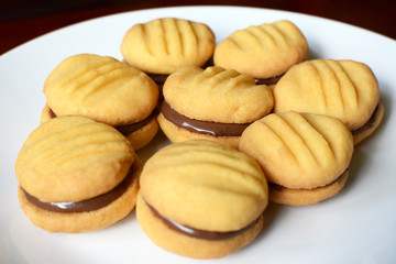 Plate of shortbread biscuits with chocolate filling