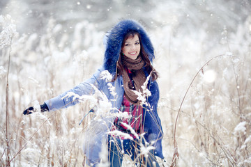 Girl having fun and jumping in the snow
