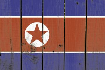 North Korea flag on wooden background