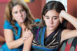 Sad teenage girl and her mother