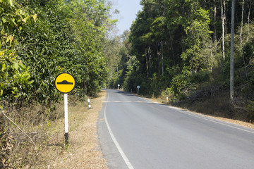 Road in park with camber sign
